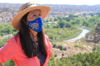 This Aug. 31, 2021 photo shows U.S. Rep. Teresa Leger Fernández during a tour of the Rio Chama valley near Abiquiu, New Mexico. Leger Fernández said the traditional irrigation systems known as acequias that supply small farms throughout the region with water hold a cultural and historic significance and need to be preserved. (AP Photo/Susan Montoya Bryan)