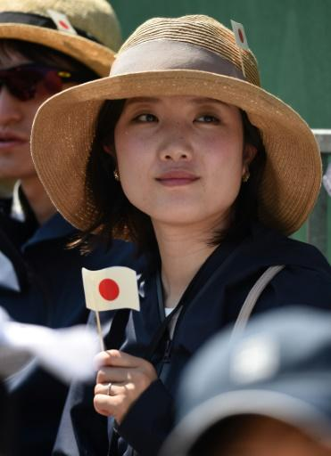 A Japanese fan watches Kei Nishikori in action at the All England Club