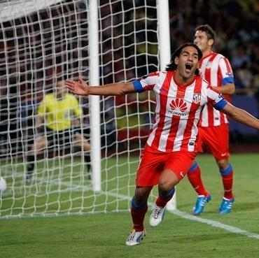 Atletico Madrid's Colombian forward Radamel Falcao Garcia, reacts after scoring his third goal against Chelsea, during the Super Cup final soccer match at the Louis II stadium, in Monaco, Friday, Aug. 31, 2012. (AP Photo/Claude Paris)