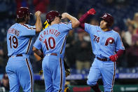 Philadelphia Phillies' Ronald Torreyes, from right, J.T. Realmuto and Matt Vierling celebrate after Torreyes' three-run home run during the sixth inning of a baseball game against the Pittsburgh Pirates, Thursday, Sept. 23, 2021, in Philadelphia. (AP Photo/Matt Slocum)