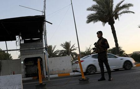FILE PHOTO: An Iraqi policeman stands guard at a check point in Baghdad, Iraq June 20, 2018. REUTERS/Thaier Al-Sudani/File Photo