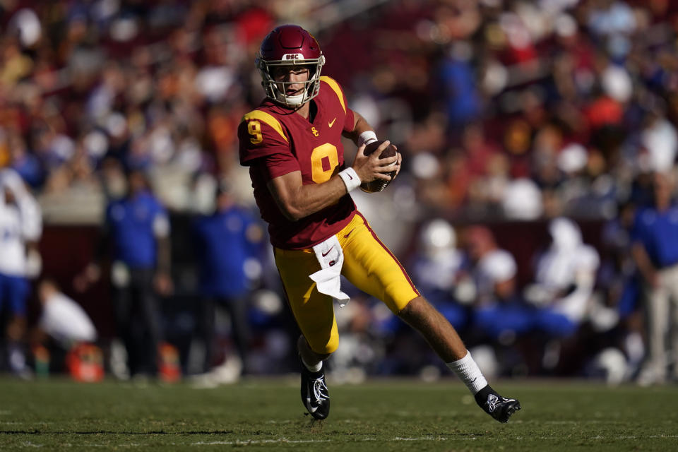 Southern California quarterback Kedon Slovis (9) runs the ball during the second half of an NCAA college football game against San Jose State Saturday, Sept. 4, 2021, in Los Angeles. (AP Photo/Ashley Landis)