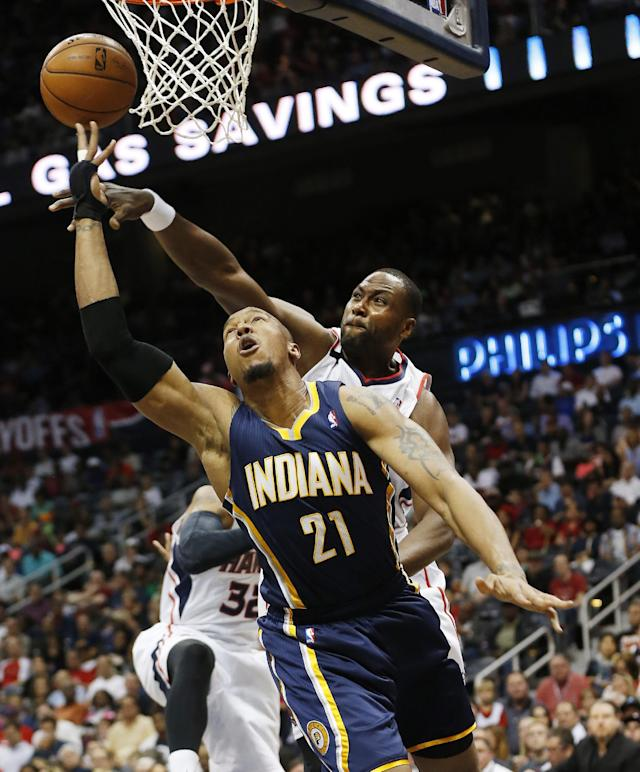 Indiana Pacers forward David West (21) goes up to shoot against Atlanta Hawks forward Elton Brand in the first half of Game 3 of an NBA basketball first-round playoff series on Wednesday, April 24, 2014 in Atlanta. (AP Photo/John Bazemore)