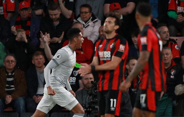 """Soccer Football - Premier League - AFC Bournemouth vs Manchester United - Vitality Stadium, Bournemouth, Britain - April 18, 2018 Manchester United's Chris Smalling celebrates scoring their first goal REUTERS/Ian Walton EDITORIAL USE ONLY. No use with unauthorized audio, video, data, fixture lists, club/league logos or """"live"""" services. Online in-match use limited to 75 images, no video emulation. No use in betting, games or single club/league/player publications. Please contact your account representative for further details."""
