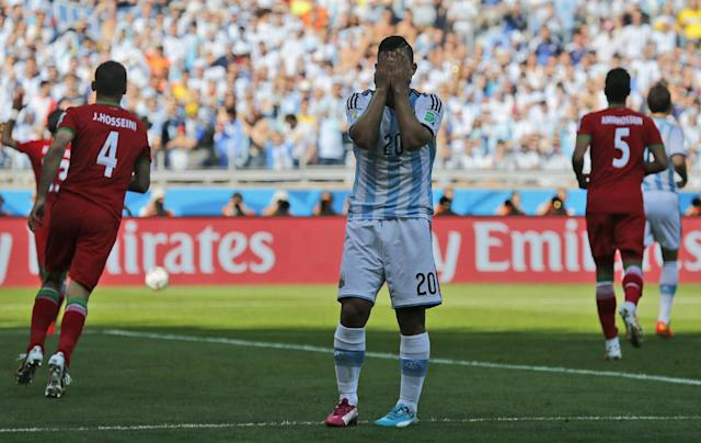 Argentina's Sergio Aguero reacts after missing a chance during the group F World Cup soccer match between Argentina and Iran at the Mineirao Stadium in Belo Horizonte, Brazil, Saturday, June 21, 2014. (AP Photo/Victor R. Caivano)