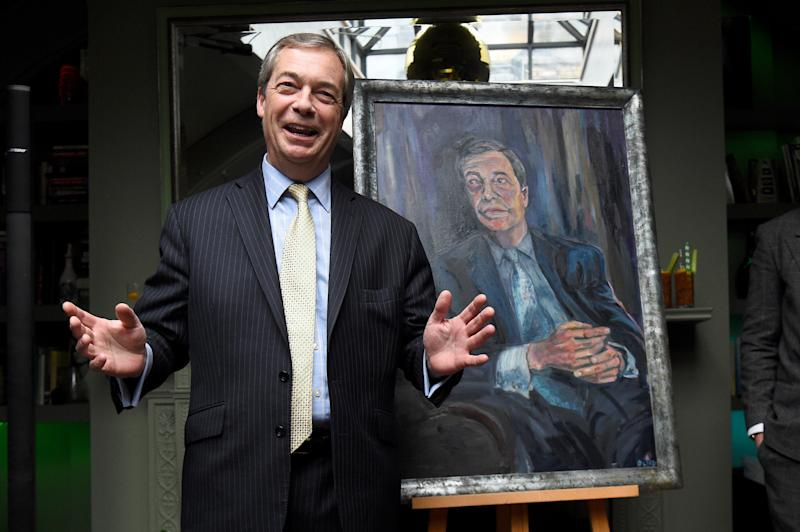 Nigel Farage during the unveiling of his 'Mr Brexit' portrait by artist Dan Llywelyn Hall at L'Escargot Restaurant in London.