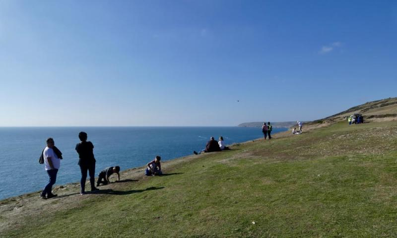 People at Anvil Point near the Tilly Whim Caves in Dorset.
