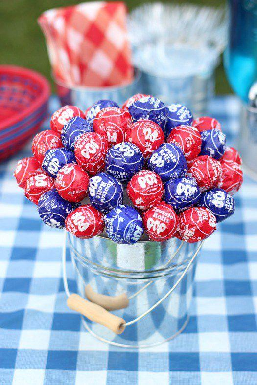 "<p>Serving double duty, this 4th of July table topper tastes as delicious as it looks.</p><p><strong>Get the tutorial at <a rel=""nofollow"" href=""http://gluesticksblog.com/2015/05/patriotic-lollipop-centerpiece.html"">Gluesticks</a>.</strong><br></p><p><strong>RELATED:</strong> <a rel=""nofollow"" href=""https://www.womansday.com/food-recipes/g1180/4th-of-july-party-ideas/"">Fantastically Festive 4th of July Party Ideas</a></p>"