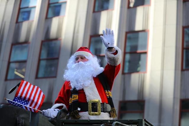 <p>Santa Claus waves to spectators during the Veterans Day parade on Fifth Avenue in New York on Nov. 11, 2017. (Photo: Gordon Donovan/Yahoo News) </p>