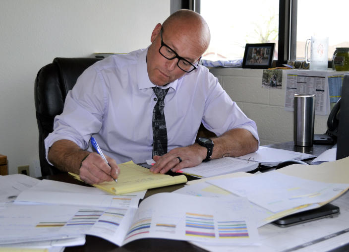 This photo provided by the Yavapai County Sheriff's Office shows Lt. Victor Dartt working from his office in Prescott, Ariz., on April 21, 2021. Dartt led the investigation into the 1988 death of Pamela Pitts, whose then-roommate, Shelly Harmon, confessed to the killing in March 2021 after already having served time for the 1991 death of an ex-boyfriend. (Yavapai County Sheriff's Office via AP)