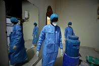 Professor Moussa Seydi, wearing his personal protective equipment (PPE) walks out after meeting his patients suffering from the coronavirus disease (COVID-19) at the infectious diseases department of the University Hospital Fann, in Dakar