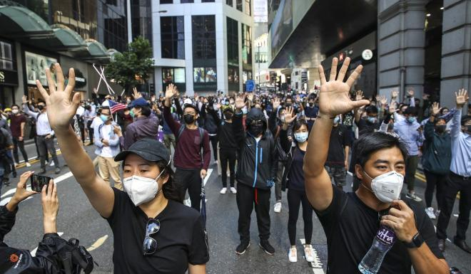 Protesters gather in the Central business district on Monday. Photo: Winson Wong