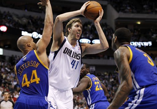 Dallas Mavericks' Dirk Nowitzki (41), of Germany, looks to pass as Golden State Warriors' Richard Jefferson (44) and Jeremy Tyler (3) defend in the first half of an NBA basketball game Friday, April 20, 2012, in Dallas. (AP Photo/Tony Gutierrez)