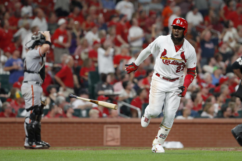 St. Louis Cardinals' Marcell Ozuna, right, drops his bat after hitting a solo home run as San Francisco Giants catcher Stephen Vogt, left, stands at the plate during the sixth inning of a baseball game Tuesday, Sept. 3, 2019, in St. Louis. (AP Photo/Jeff Roberson)