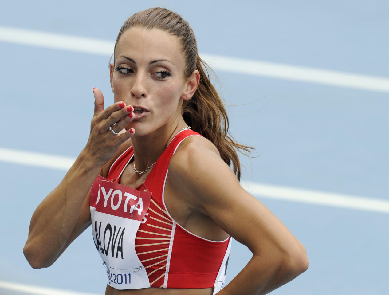 Bulgaria's Ivet Lalova gestures after qualifying for the Women's 100m following a heat at the World Athletics Championships in Daegu, South Korea, Sunday, Aug. 28, 2011. (AP Photo/Martin Meissner)