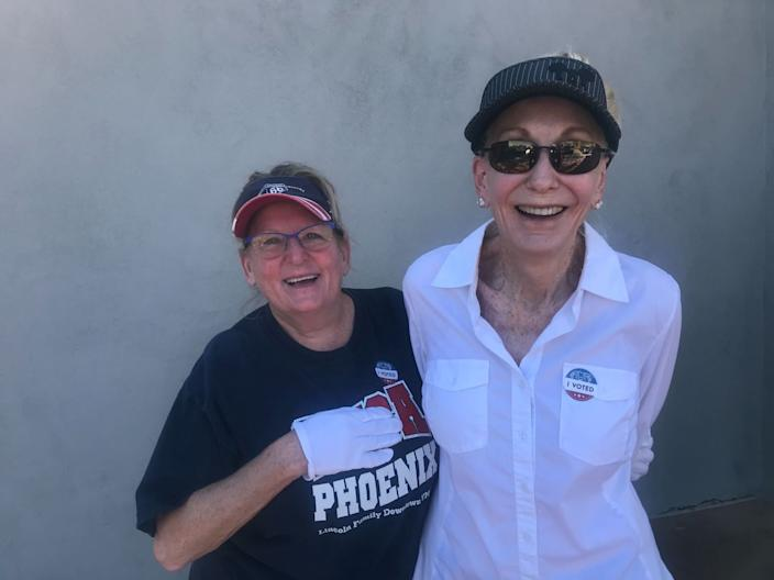 Donnette Hermes and Susan Stewart stand together at a south Phoenix strip mall.
