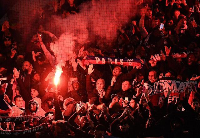 PSG lit flares during their team's win at Manchester United on Tuesday (AFP Photo/FRANCK FIFE)
