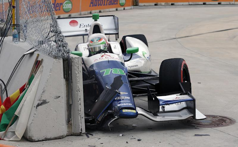 Simona de Silvestro crashes in the eighth turn during the IndyCar Detroit Grand Prix auto race on Belle Isle in Detroit, Sunday, June 2, 2013. (AP Photo/Carlos Osorio)