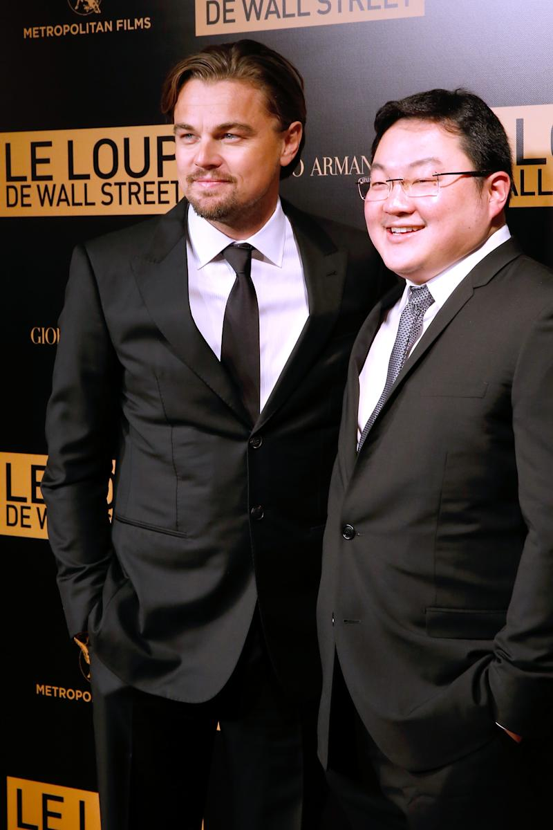 PARIS, FRANCE - DECEMBER 09: Actor Leonardo DiCaprio with Jho Low (right) of the movie attend the photocall before the 'The Wolf of Wall Street' World movie Premiere at Cinema Gaumont Opera on December 9, 2013 in Paris, France. (Photo by Bertrand Rindoff Petroff/Getty Images)