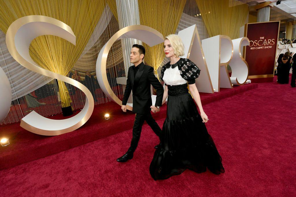 <p>Lucy Boynton and Rami Malek gripped each other's hands supportively as they arrived on the red carpet. The two have been dating since 2017 when they met while filming Bohemian Rhapsody.</p>