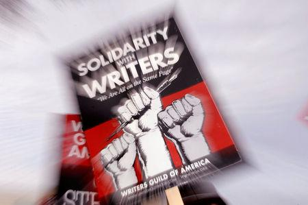 FILE PHOTO - A picket sign from the Writers Guild of America is seen as members protest in Burbank