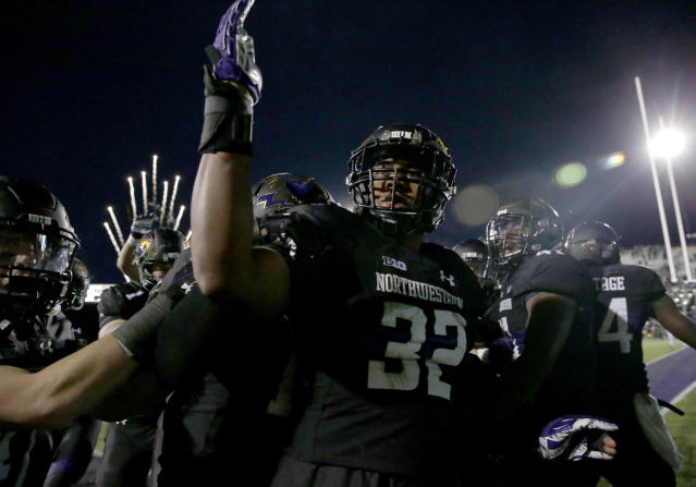 Northwestern linebacker Nate Hall celebrates with teammates after intercepting a pass from Michigan State quarterback Brian Lewerke in triple overtime in 2017. (AP)