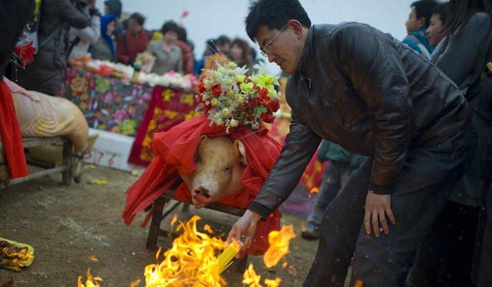 People in China burn joss paper at a festival ahead of fishing season in the hopes that it will bring them good luck. Photo: Getty Images