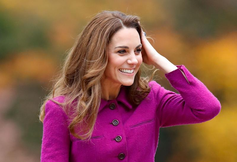 Kate Middleton out in a purple coat