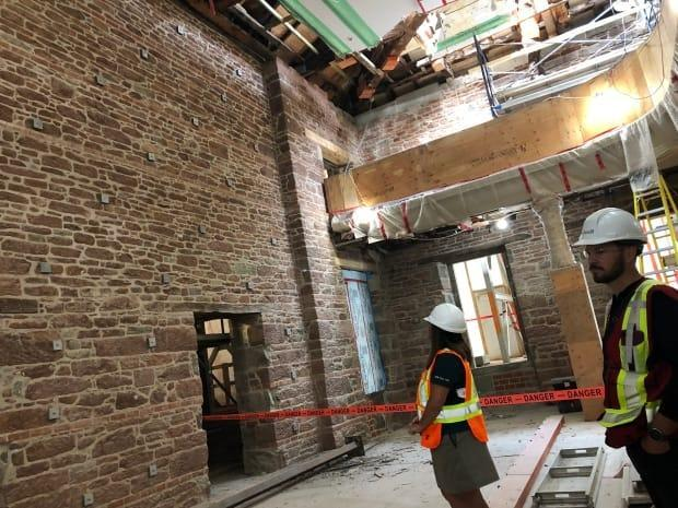 About 20 per cent of the stone blocks in this interior wall of the Confederation Chamber of Province House have been replaced with new ones. The wall is now structurally sound, according to site officials, and further restoration work can proceed. (Brian Higgins/CBC - image credit)