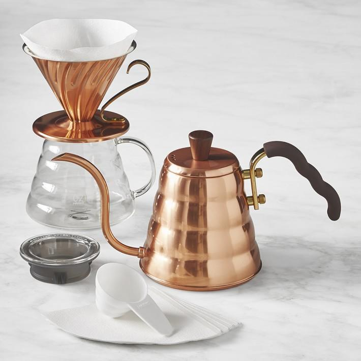 """<p>Take your pour-overs to the next level with this handsome copper kit for manual brewing. It features a Hario V60 Copper kettle for controlled pouring, a copper dripper that lets you customize your coffee flavor and strength, a heatproof glass pot, and V60 coffee filters. The end result: A full-bodied, complex cup of coffee.</p> <p><strong><em>Buy Now</em></strong><em>: Hario Pour-Over Kit Copper, $149.98 <a href=""""https://williams-sonoma.pdy5.net/c/249354/265127/4291?subId1=MSLBrewingPerfectionOurShoppableGuidetotheBestCoffeeMakersvspence2FooGal7987783202009I&u=https%3A%2F%2Fwww.williams-sonoma.com%2Fproducts%2Fhario-pour-over-kit-copper%2F%3Fpkey%3Dcspecialty-coffee-maker%26amp%3Bisx%3D0.0.4587"""" rel=""""nofollow noopener"""" target=""""_blank"""" data-ylk=""""slk:williams-sonoma"""" class=""""link rapid-noclick-resp"""">williams-sonoma</a>.</em></p>"""
