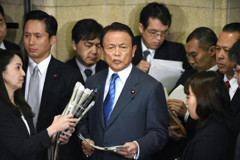 Japan's Finance Minister Taro Aso (C) has dismissed suggestions that he might resign over the scandal