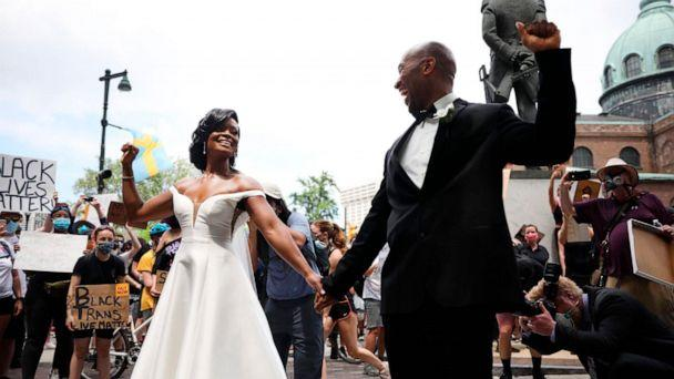 PHOTO: Kerry Anne and Michael Gordon came out to the crowd during a protest, June 6, 2020 in Philadelphia over the death of George Floyd. (Tyger Williams/The Philadelphia Inquirer via AP)