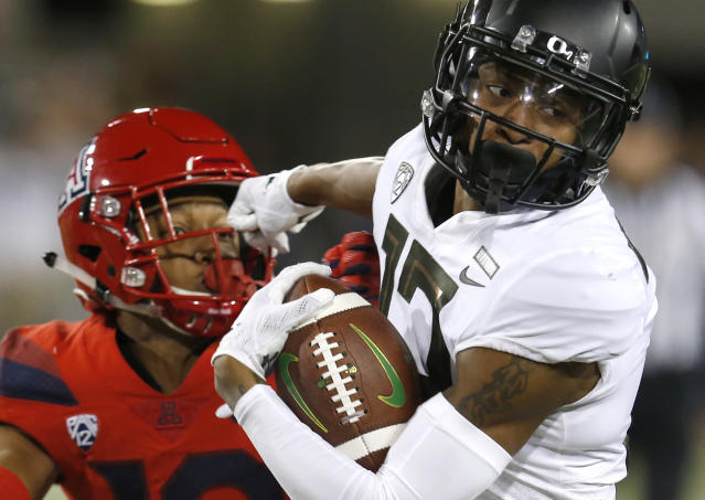 FILE - In this Oct. 27, 2018, file photo, Oregon wide receiver Dillon Mitchell (13) during an NCAA college football game against Arizona, in Tucson, Ariz. Justin Herbert is one of the league's better passers. Herbert has thrown for 2,333 yards and 22 touchdowns while completing 59 percent of his passes. Herbert's top target, Mitchell, leads the Pac-12 with 833 yards and six touchdowns on 56 catches. (AP Photo/Rick Scuteri, File)