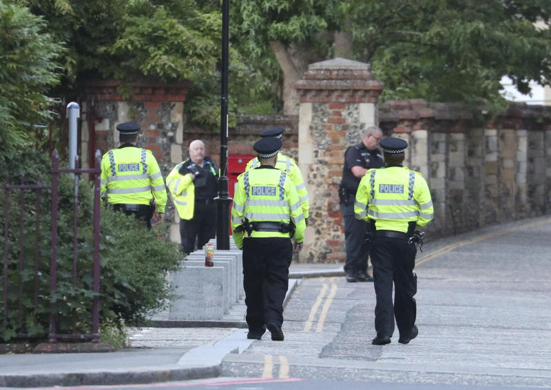 """Police arrive at Forbury Gardens in the town centre of Reading, England, where they are responding to a """"serious incident"""" Saturday, June 20, 2020. (Steve Parsons/PA via AP)"""