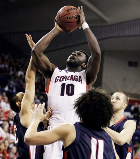 Gonzaga's Tommy Sperry (10) shoots against Lewis-Clark State's Jacob Champoux (11) during the first half of an NCAA college basketball game in Spokane, Wash., Thursday, Nov. 29, 2012. (AP Photo/Young Kwak)