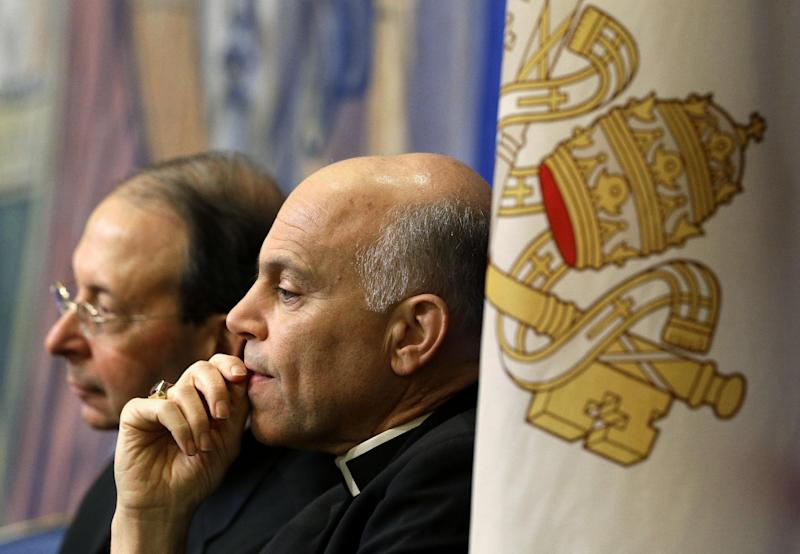 Archbishop Salvatore Cordileone, of San Francisco, center, and Archbishop William Lori, of Baltimore, listen to a speaker during the United States Conference of Catholic Bishops' annual fall meeting in Baltimore, Monday, Nov. 12, 2012, after addressing the group. (AP Photo/Patrick Semansky)