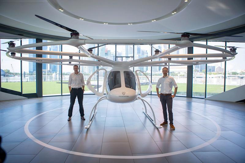 Volocopter CEO Florian Reuter (right) and Skyports managing director Duncan Walker standing next to a two-seat Volocopter electric air taxi at the VoloPort press conference in Singapore on 21 October 2019. (PHOTO: Dhany Osman / Yahoo News Singapore)