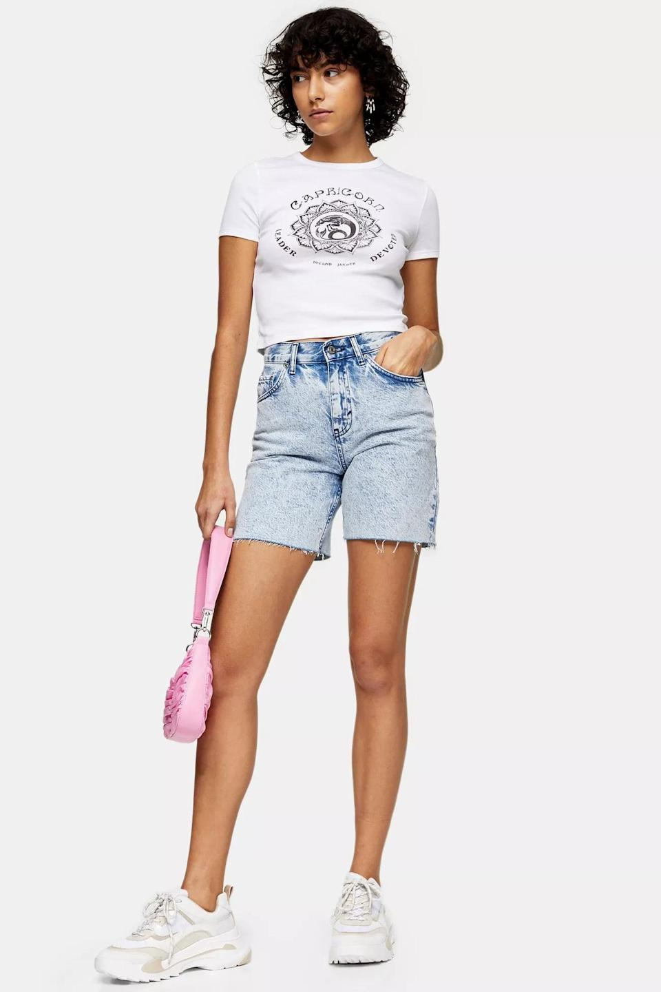 "<p>How cool are these <a href=""https://www.popsugar.com/buy/Topshop-Acid-Wash-Mid-Rise-Denim-Shorts-582004?p_name=Topshop%20Acid%20Wash%20Mid%20Rise%20Denim%20Shorts&retailer=us.topshop.com&pid=582004&price=65&evar1=fab%3Aus&evar9=35329485&evar98=https%3A%2F%2Fwww.popsugar.com%2Ffashion%2Fphoto-gallery%2F35329485%2Fimage%2F47550210%2FTopshop-Acid-Wash-Mid-Rise-Denim-Shorts&list1=shopping%2Cdenim%2Csummer%20fashion%2Cfashion%20shopping&prop13=mobile&pdata=1"" class=""link rapid-noclick-resp"" rel=""nofollow noopener"" target=""_blank"" data-ylk=""slk:Topshop Acid Wash Mid Rise Denim Shorts"">Topshop Acid Wash Mid Rise Denim Shorts</a> ($65)?</p>"