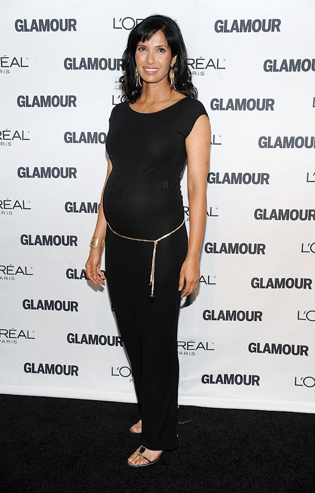 "A pregnant Padma Lakshmi simply glowed in a basic black dress with gold accents. Dimitrios Kambouris/<a href=""http://www.wireimage.com"" target=""new"">WireImage.com</a> - November 9, 2009"