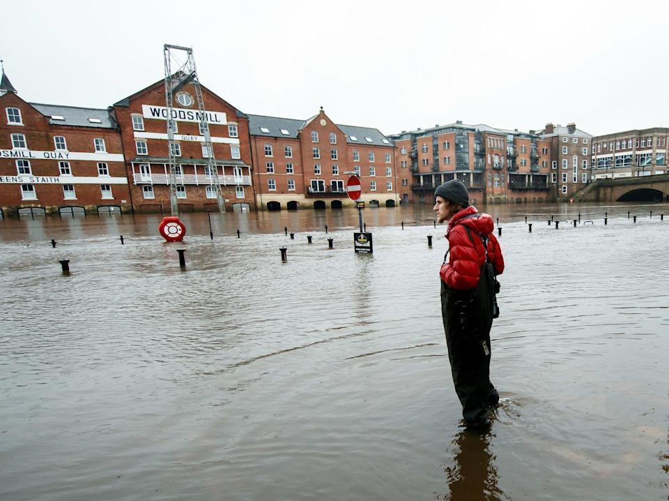 A person stands in flood water in York as Storm Christoph is set to bring widespread flooding, gales and snow to parts of the UK.  (Danny Lawson/PA)