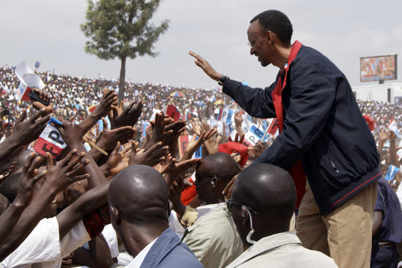 FILE - In this Aug. 2, 2010, file photo President Paul Kagame of Rwanda shakes hands with Rwandans at a rally in Gicumbi, Rwanda. Adoring crowds swarm around Rwanda's president when he travels across the country, many begging him to run again when his current term expires. In the state-controlled press, more and more admirers are heaping praise on President Paul Kagame and urging a change in the country's constitution that would allow him more time in office. Rwanda's next presidential election is still four years away, but a movement is growing there for term limits to be removed so that Kagame can still be in charge of the country after 2017, when his current term expires. Rwanda's constitution provides for two, seven-year presidential terms. (AP Photo / Margaret Cappa, File)
