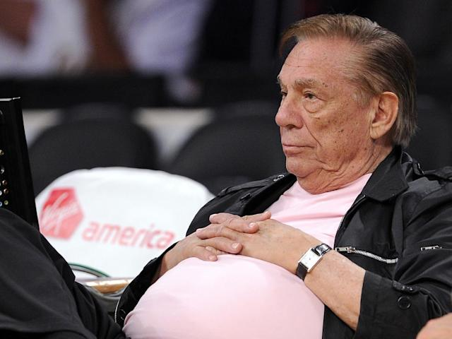 "FILE - In this Oct. 17, 2010 file photo, Los Angeles Clippers team owner Donald Sterling watches his team play in Los Angeles. The NBA is investigating a report of an audio recording in which a man purported to be Sterling makes racist remarks while speaking to his girlfriend. NBA spokesman Mike Bass said in a statement Saturday, APril 26, 2014, that the league is in the process of authenticating the validity of the recording posted on TMZ's website. Bass called the comments ""disturbing and offensive."" (AP Photo/Mark J. Terrill, File)"