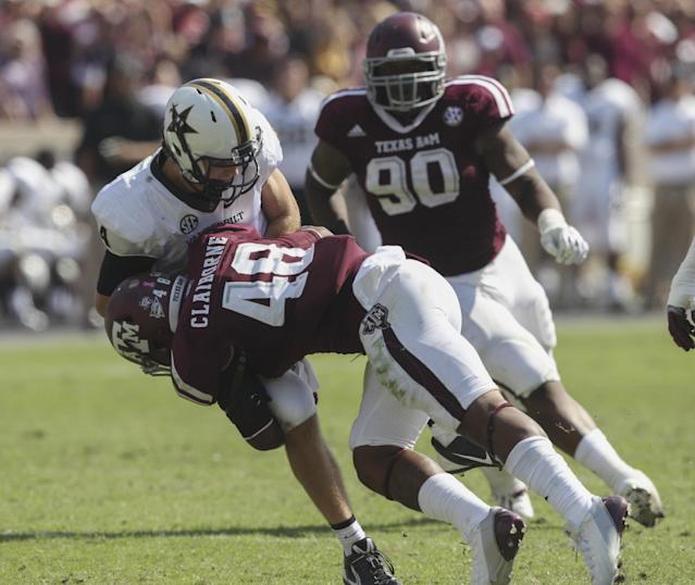 COLLEGE STATION, TX - OCTOBER 26: Darian Claiborne #48 of the Texas A&M Aggies lays a hard hit on Patton Robinette #4 of the Vanderbilt Commodores at Kyle Field on October 26, 2013 in College Station, Texas. (Photo by Bob Levey/Getty Images)