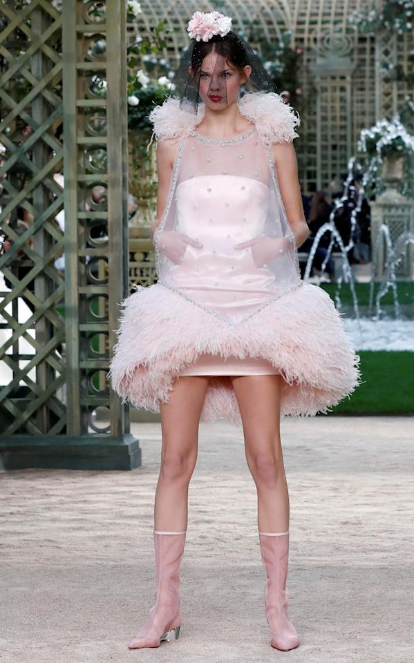 A model presents a creation by German designer Karl Lagerfeld as part of his Haute Couture Spring-Summer 2018 fashion collection for fashion house Chanel in Paris, France January 23, 2018. REUTERS/Gonzalo Fuentes