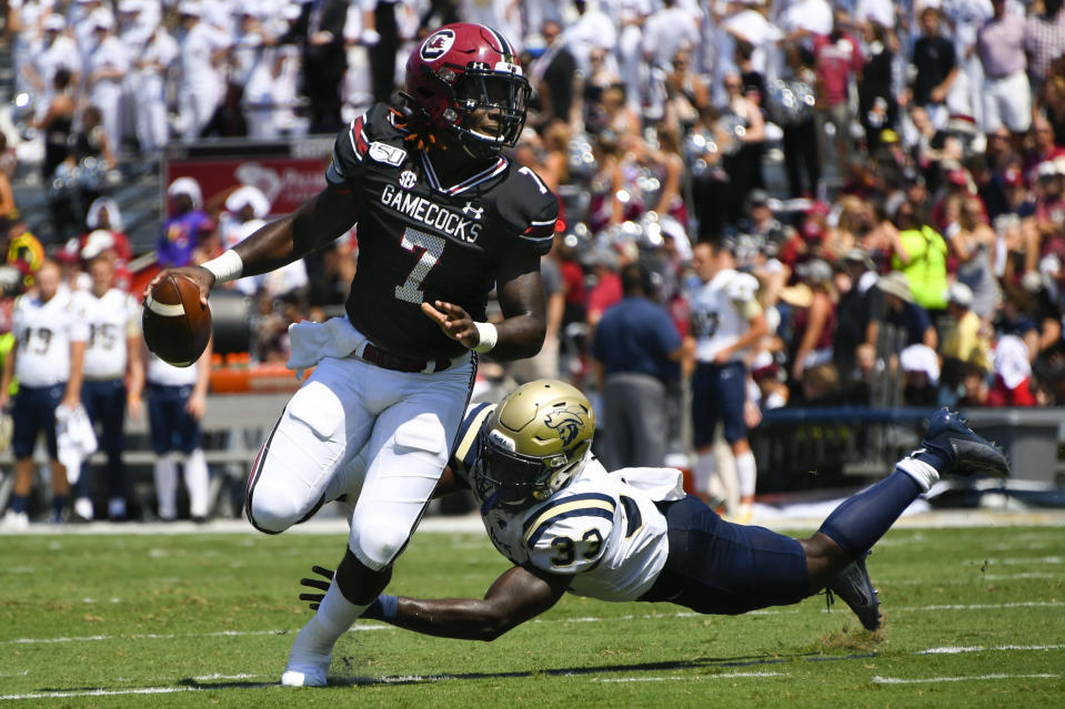 South Carolina quarterback Dakereon Joyner (7) evades the tackle of Charleston Southern defensive end Nick Salley on the way to a touchdown during the first half of an NCAA college football game Saturday, Sept. 7, 2019, in Columbia, S.C. (AP Photo/John Amis)
