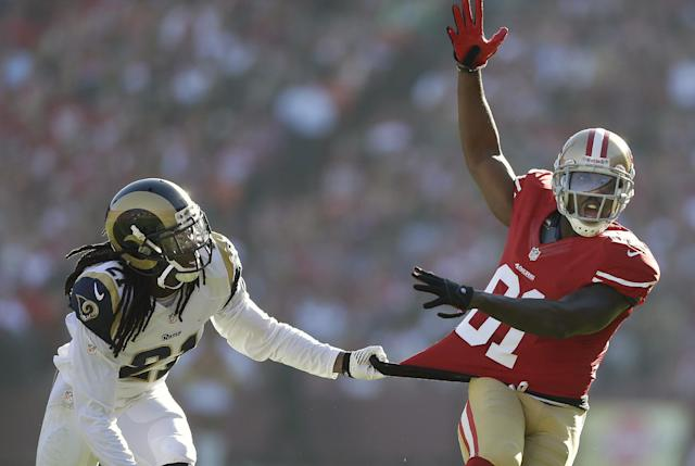 San Francisco 49ers wide receiver Anquan Boldin, right, yells as he is grabbed by St. Louis Rams cornerback Janoris Jenkins during the first quarter of an NFL football game in San Francisco, Sunday, Dec. 1, 2013. Jenkins was penalized on the play. (AP Photo/Marcio Jose Sanchez)