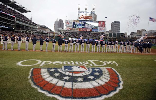 Balloons fly during the national anthem before a baseball game between the Minnesota Twins and the Cleveland Indians, Friday, April 4, 2014, in Cleveland. (AP Photo/Tony Dejak)