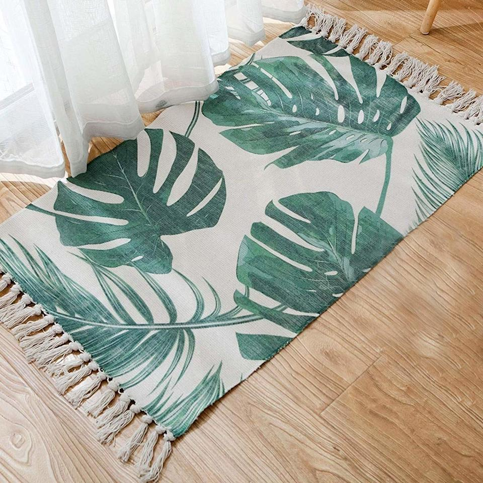 """<h2>Seavish Decorative Palm Tree Leaves with Tassels Kilim Entryway Rug</h2> <p>Keep the honeymoon vibes going <em>after</em> your post-wedding getaway with this bohemian, cotton rag rug with tropical palms and festive tassel fringe.</p> <p>SHOP NOW: <a href=""""https://www.amazon.com/Printed-Seavish-Decorative-Tassels-Entryway/dp/B07PKBFQ9W/"""" rel=""""nofollow"""">Amazon</a>, $17</p>"""