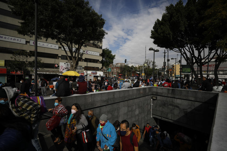 FILE - In this Dec. 4, 2020 file photo, people emerge from the Pino Suarez subway station, in Mexico City. According to a report released the third week of April, by the University of California, San Francisco, Mexico would have had a significantly lower COVID-19 death toll if it had reacted as well as the average government. (AP Photo/Rebecca Blackwell, File)