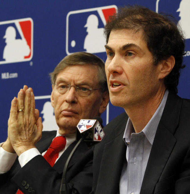 FILE - In this Nov. 22, 2011, file photo, Major League Baseball Commissioner Bud Selig, left, and MLB Players Association Executive Director Michael Weiner hold a news conference announcing a five-year collective bargaining agreement in New York. Weiner, the plain-speaking, ever-positive labor lawyer who took over as head of the powerful baseball players' union four years ago and smoothed the group's perennially contentious relationship with management, died Thursday, Nov. 21, 2013, 15 months after announcing he had been diagnosed with an inoperable brain tumor. He was 51. (AP Photo/Bebeto Matthews, File)